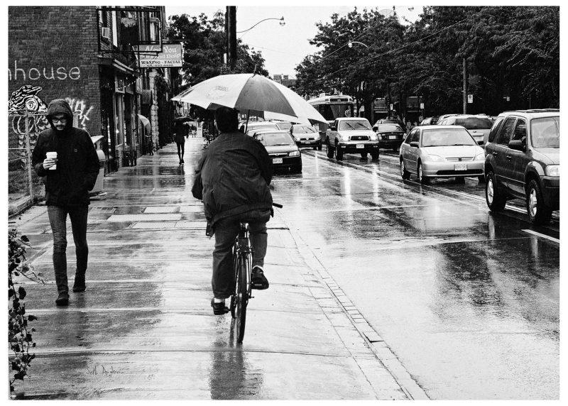 biking in the rain bike rain strangers traffic umbrella b12